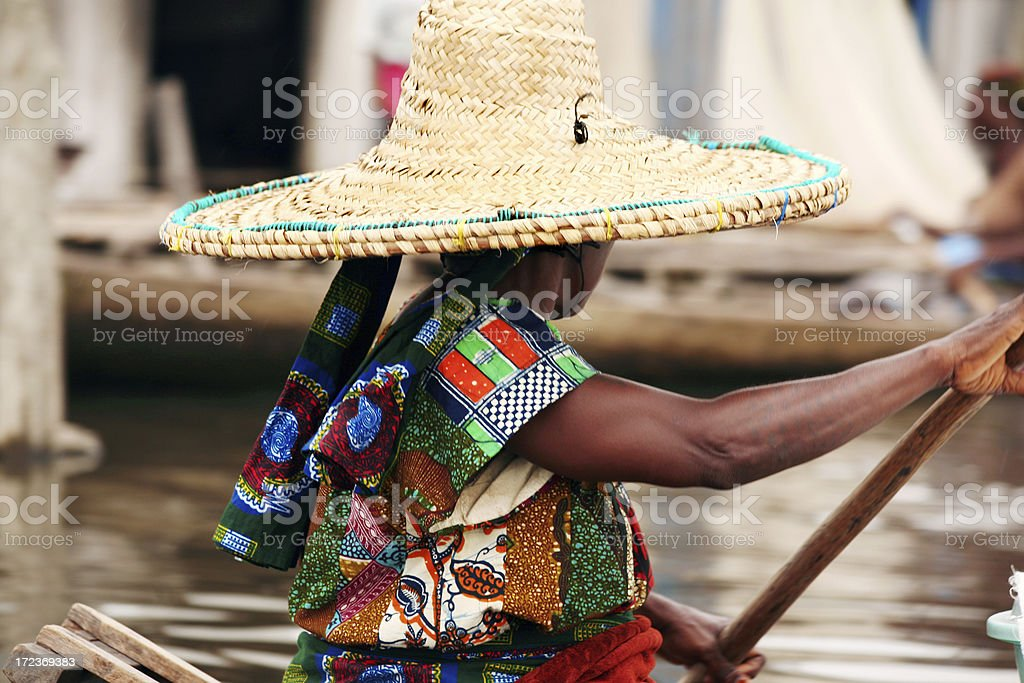 african woman on boat stock photo