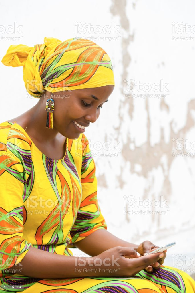 African woman on the phone stock photo