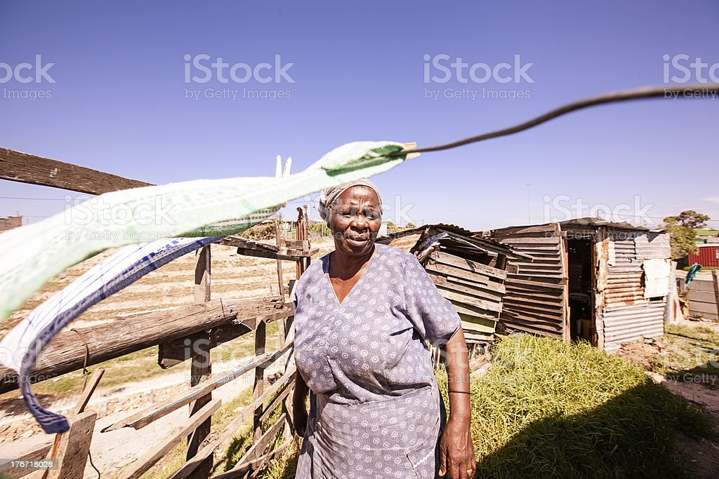 African Woman picking washing, Gugulethu, Cape Town royalty-free stock photo