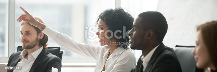istock African woman raise hand ask question during seminar at boardroom 1132941117