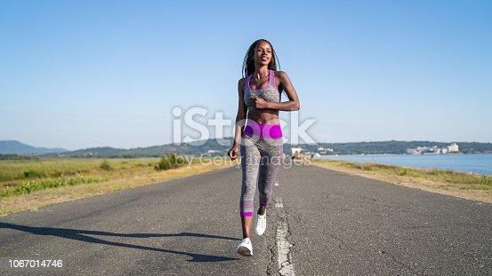 African woman running near the sea