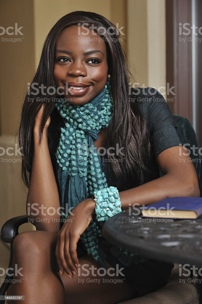 African woman sitting stock photo