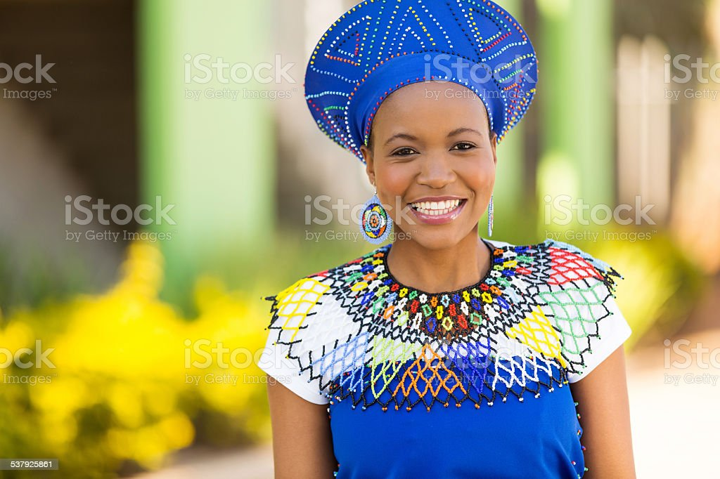african woman standing outdoors stock photo