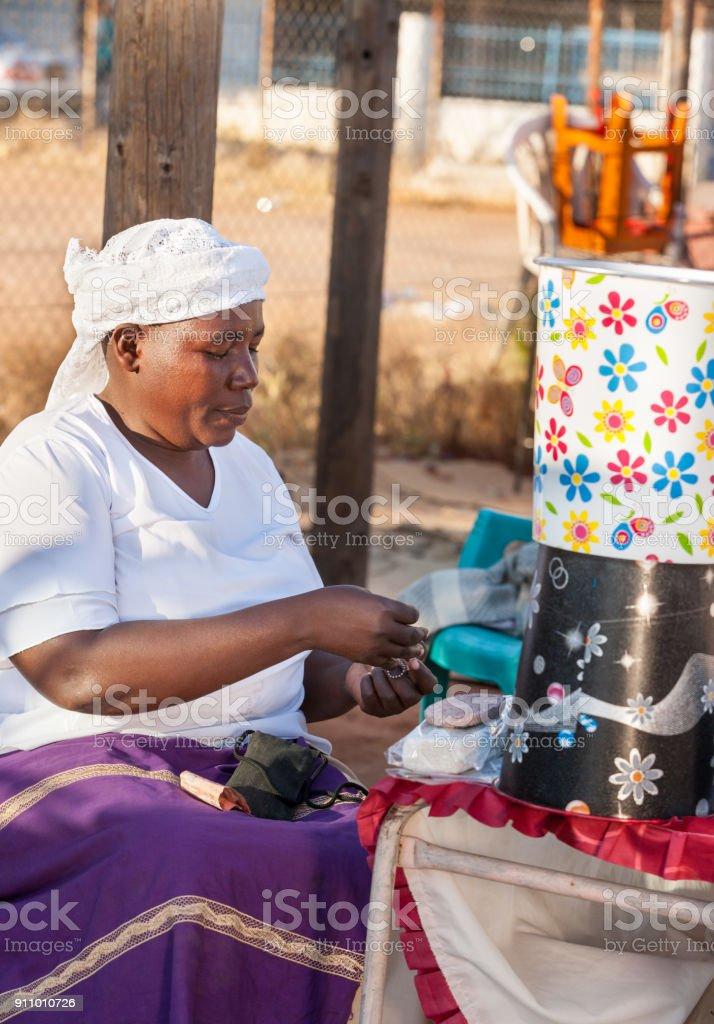 African woman street vendor stock photo