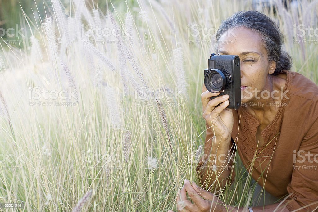 African woman taking photographs outdoors royalty-free stock photo