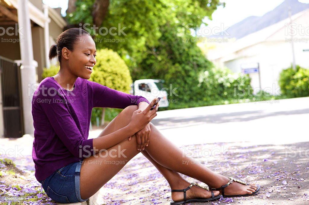 African woman using mobile phone stock photo