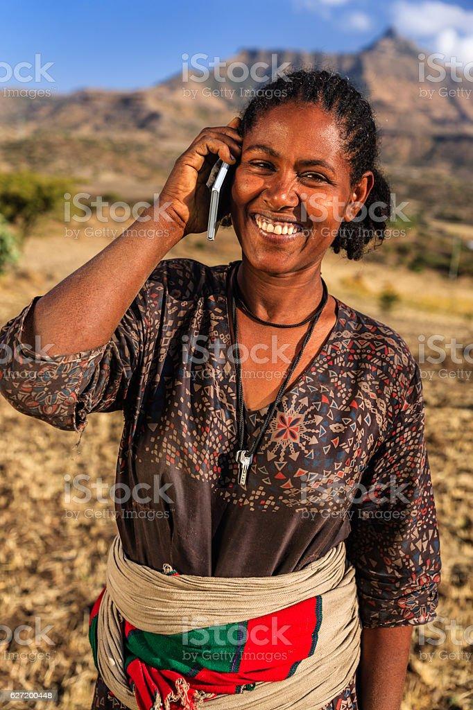 African woman using mobile phone, village near Lalibela, Ethiopia stock photo