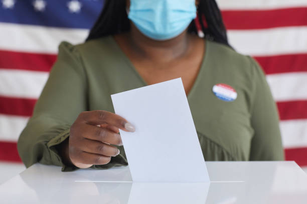 African Woman Voting in Pandemic Close Up stock photo