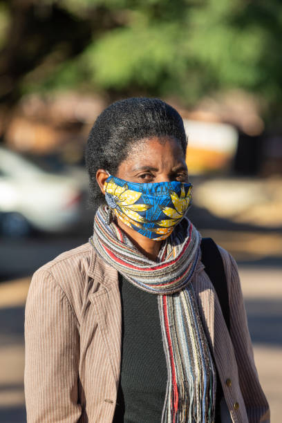 African woman wearing a colorful face mask