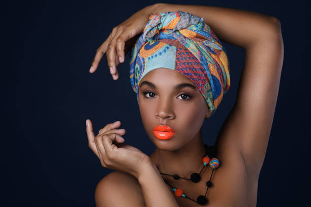 African woman with a colorful shawl on her head stock photo