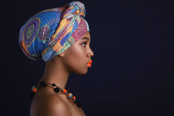 african woman with a colorful shawl on her head - african ethnicity stock pictures, royalty-free photos & images