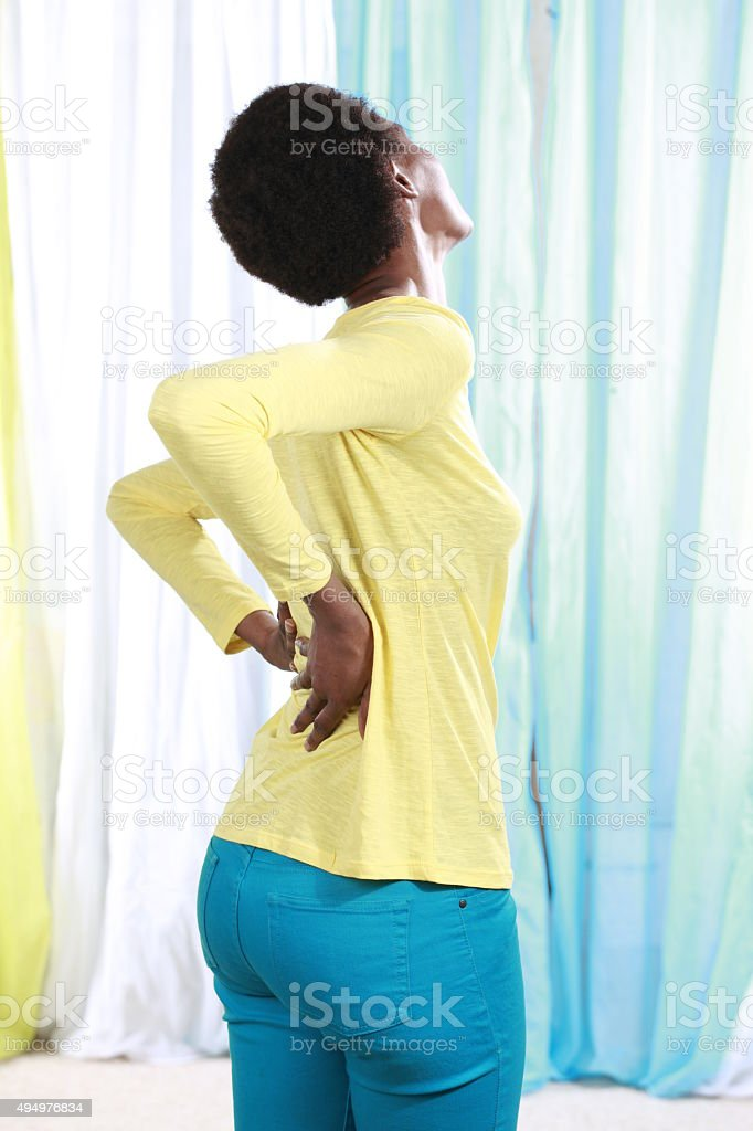 African woman with back pain stock photo