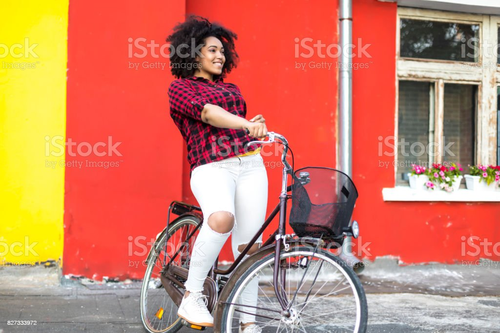 African woman with bike on street стоковое фото
