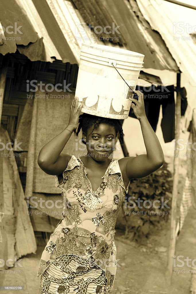 African Woman with Bucket stock photo