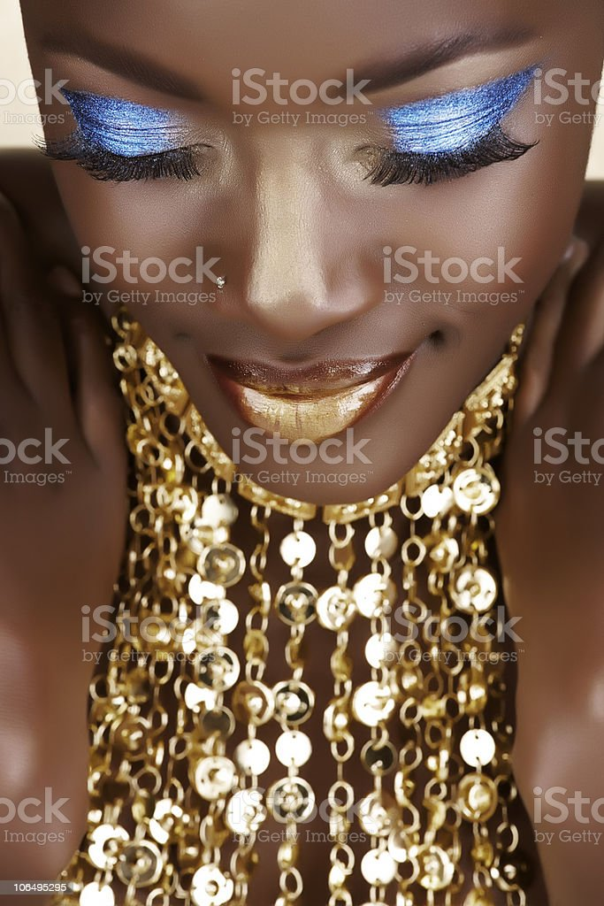 African woman with gold and blue metallic make-up royalty-free stock photo