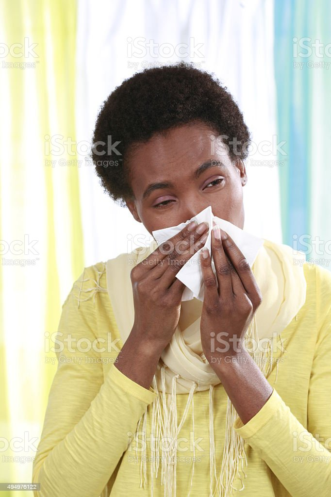 African woman with handkerchief and cold stock photo