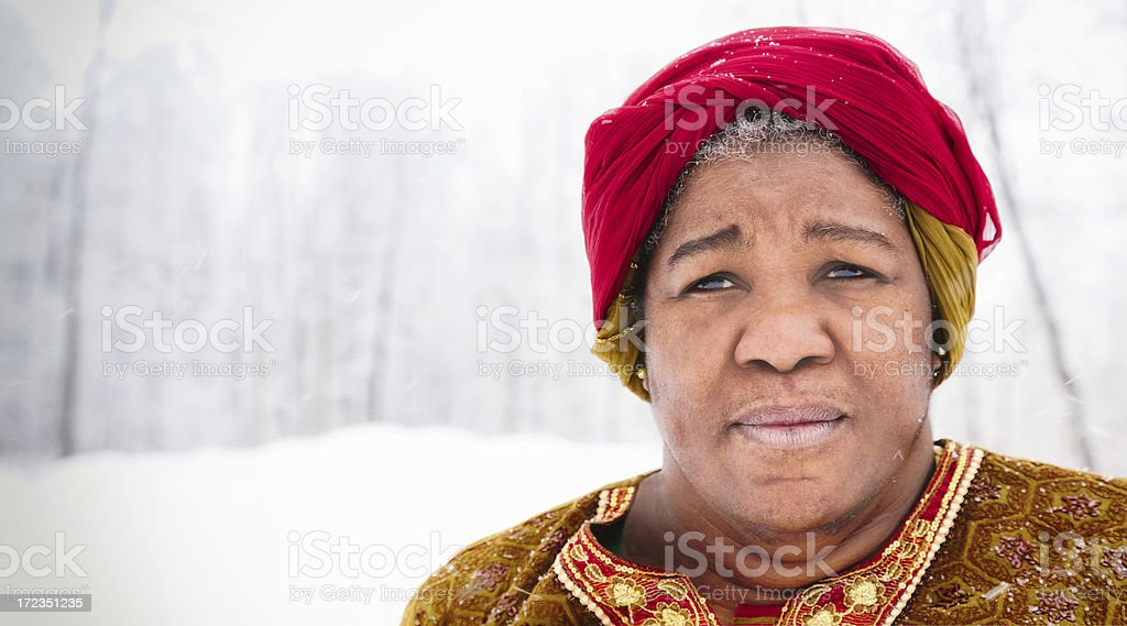 African Woman with Head scarf snow storm close-up royalty-free stock photo