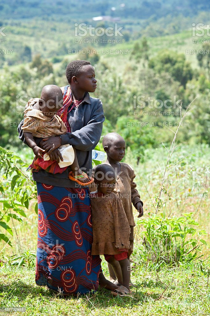 African woman with her children in a field, Burundi, Africa stock photo