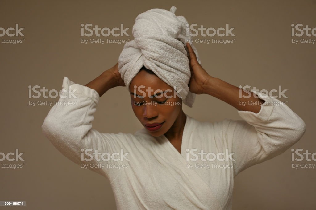 African woman wrapped in towels after bath. stock photo