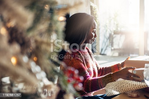 African woman wrapping christmas gifts, Quebec, Canada
