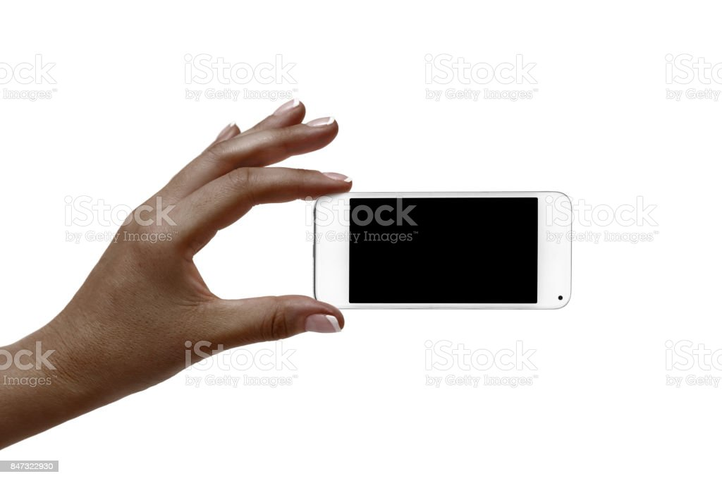 African woman's hand holds a white phone on a white background. stock photo