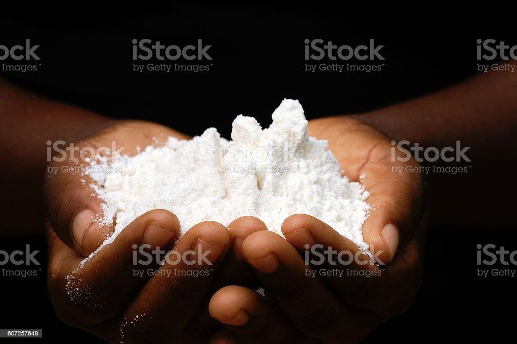 African woman´s hands holding maize flour. – Foto