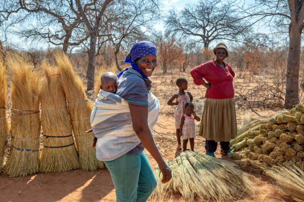 African women with their children walking in the bush