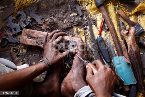 African woodcarver cutting african animals from ebony wood. See my other photos from Kenya: