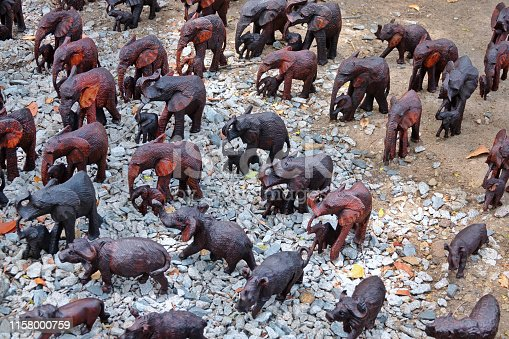 Wooden small elephants for sale at the market stall in Zambia.