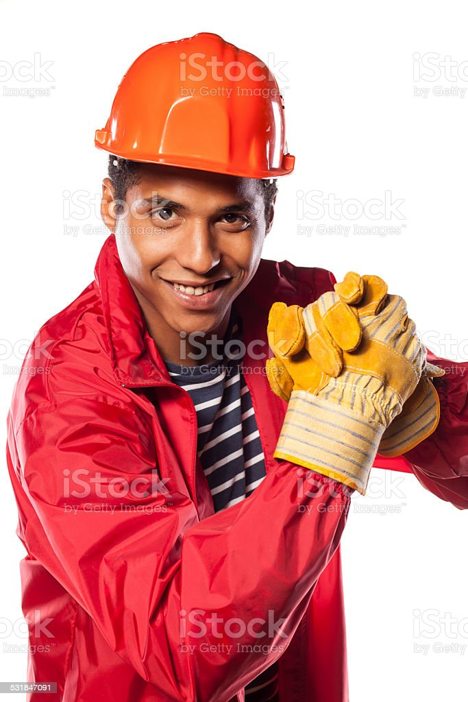 African worker with a helmet and a gesture of congratulations stock photo