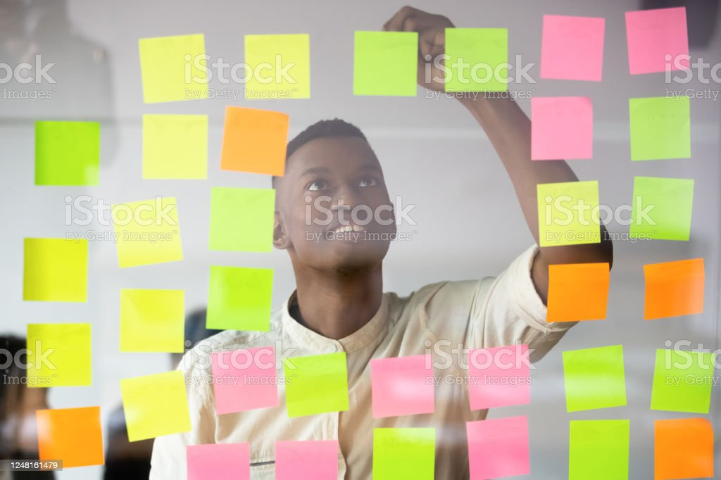 African Worker Writing On Colorful Sticky Notes Produces Fresh Ideas Stock Photo Download Image Now Istock