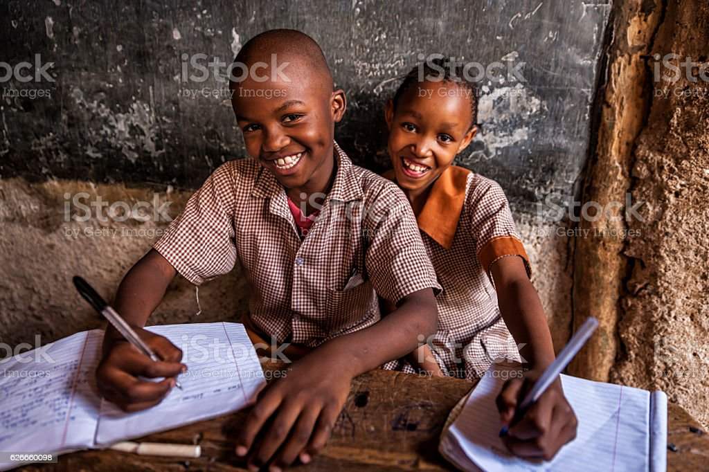 African young boys are learning English language, orphanage in Kenya stock photo