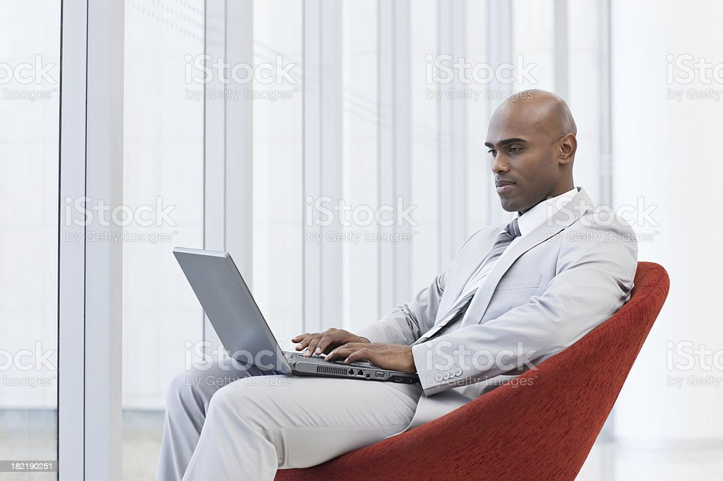African young businessman working on a laptop royalty-free stock photo