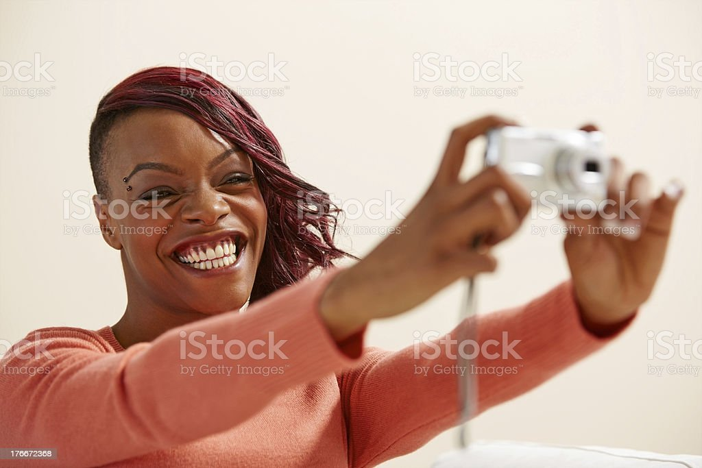 African young lady taking photos with digital camera royalty-free stock photo