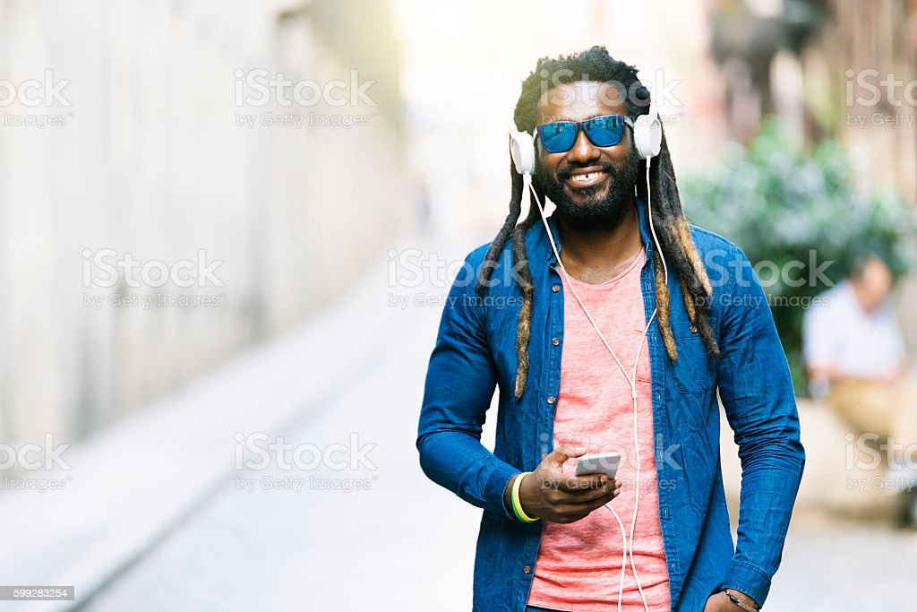 African Young Man Listening Music. stock photo