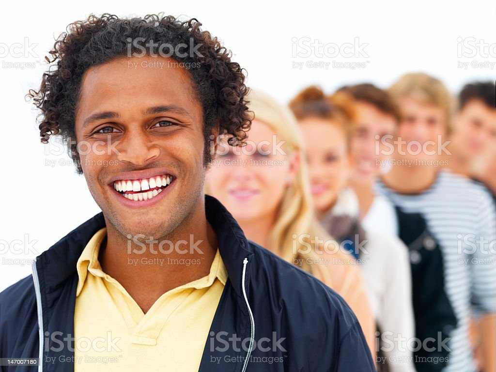 African young man with friends in the background royalty-free stock photo