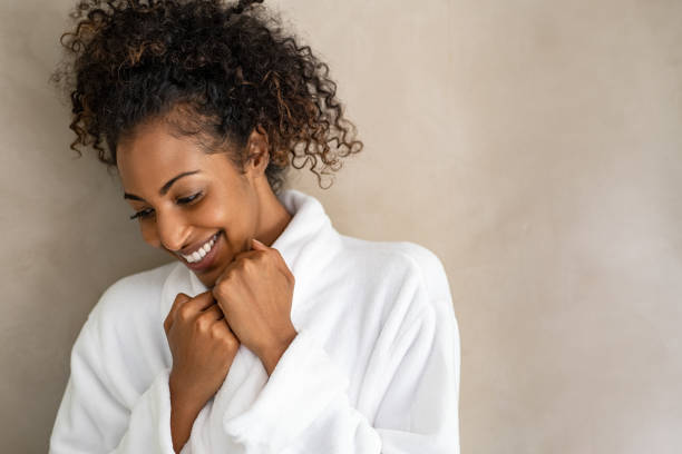 african young woman in bath robe at spa - accappatoio foto e immagini stock