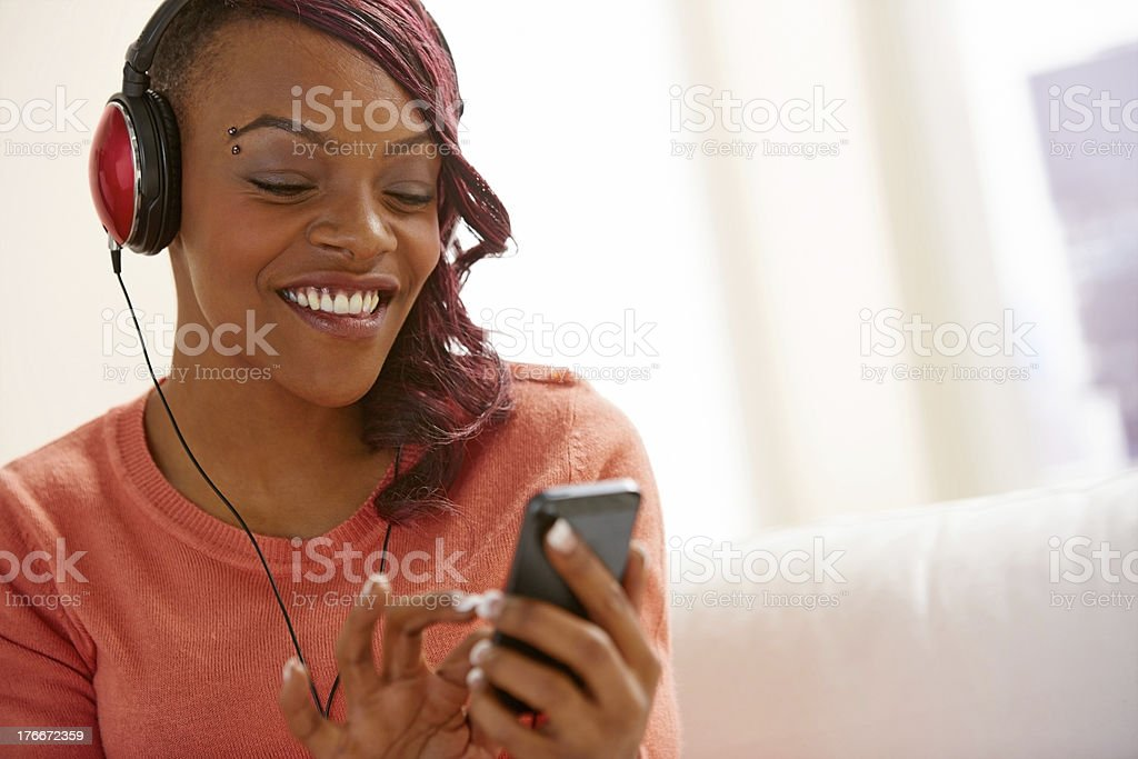 African young woman listening to music on phone royalty-free stock photo