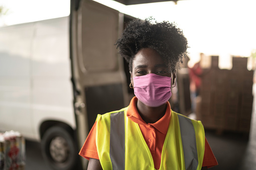 African young woman portrait at warehouse with face mask