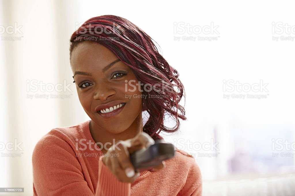 African young woman watching television royalty-free stock photo