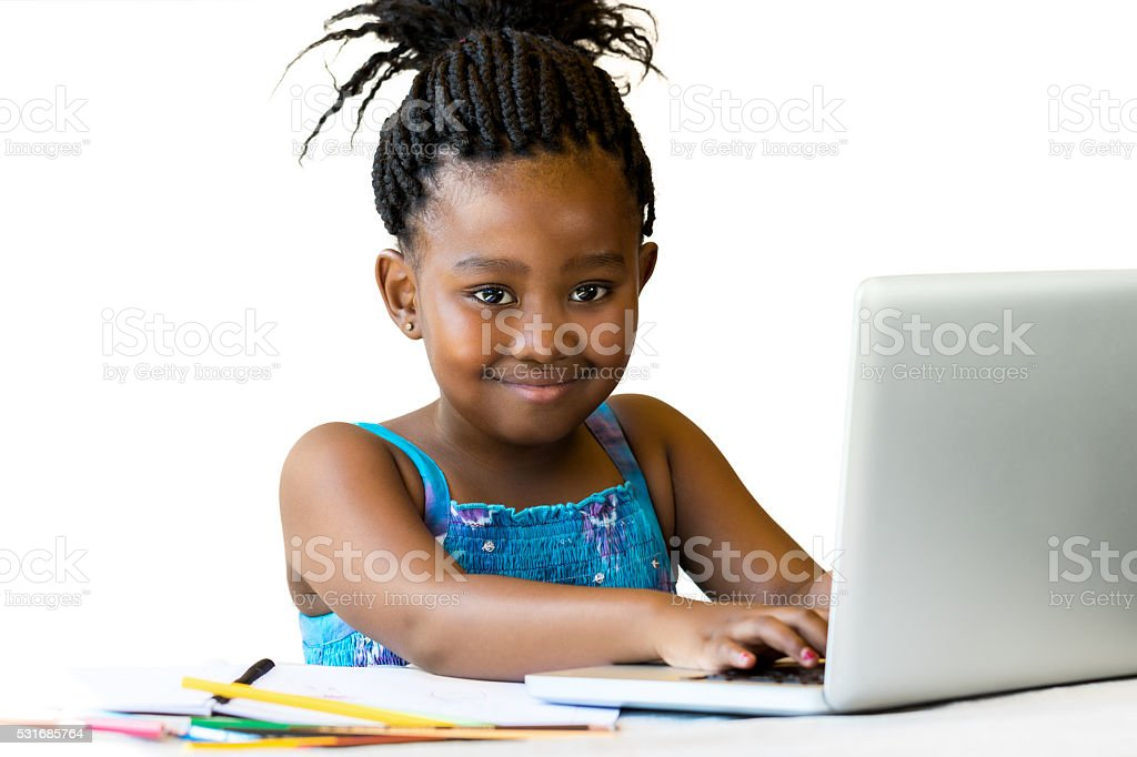 African youngster sitting with hands on keyboard. stock photo
