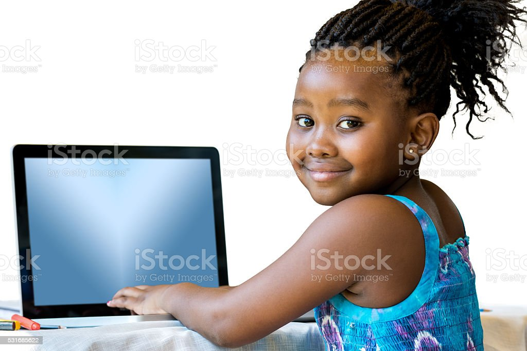 African youngster typing on laptop. stock photo