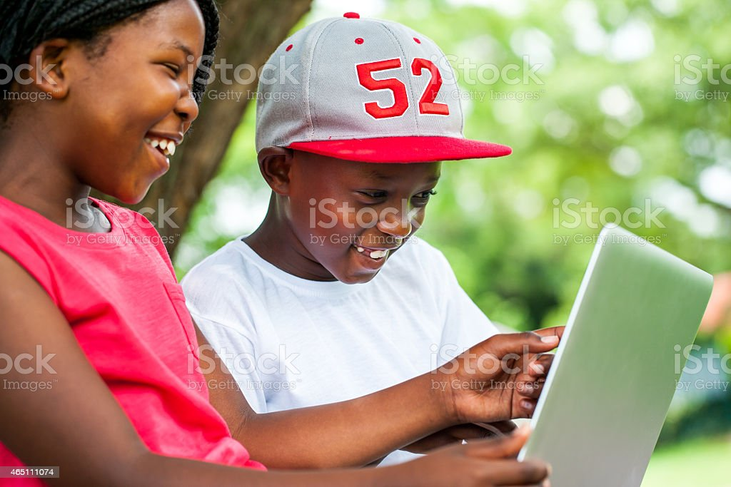 African youngsters enjoying time with laptop. stock photo