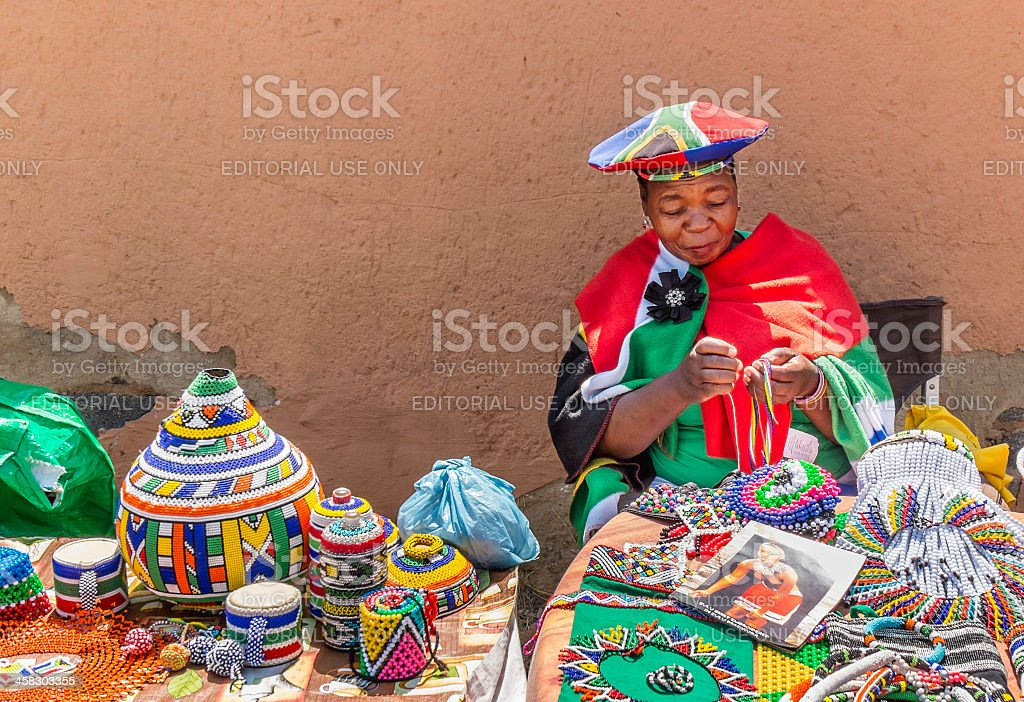 African Zulu lady doing beadwork stock photo