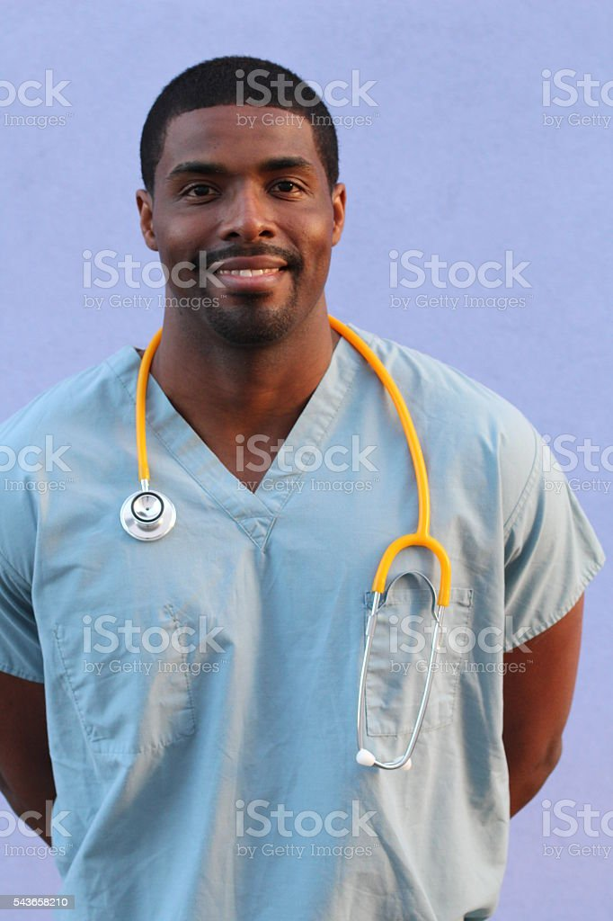 African-American black doctor man isolated on blue stock photo