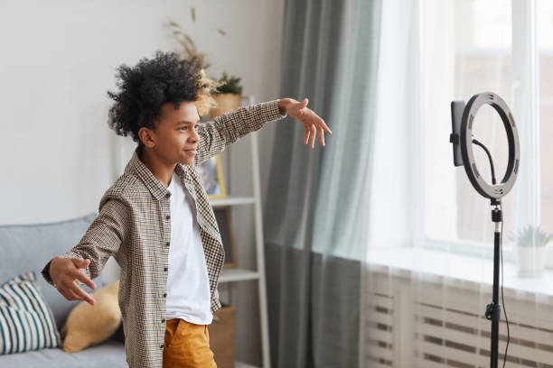 African-American Boy Filming Videoblog stock photo