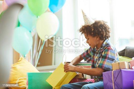 istock African-American Boy Opening Birthday Presents 1156938981