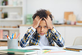 istock African-American Boy Studying at Home 1225545078