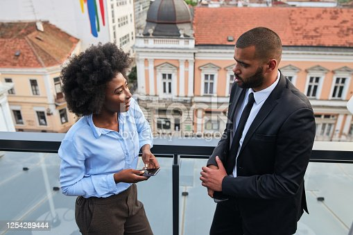 istock African-American business colleagues talking outdoors 1254289444