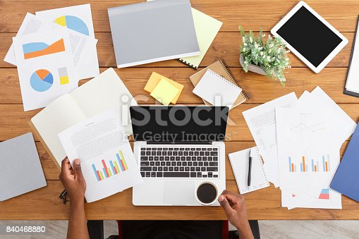 istock African-american businessman at work, table top view 840468880